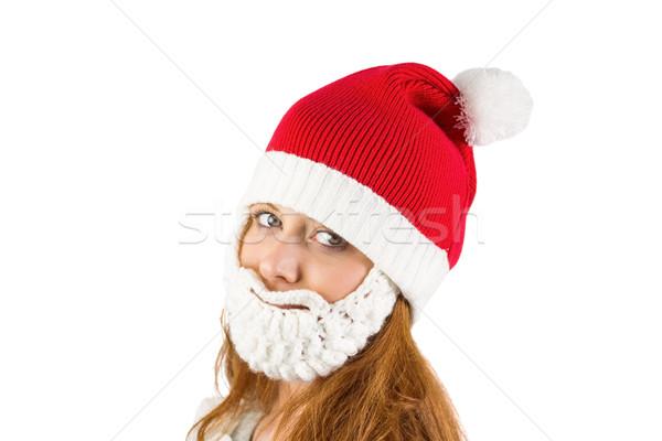 Pretty redhead in santa hat and beard Stock photo © wavebreak_media