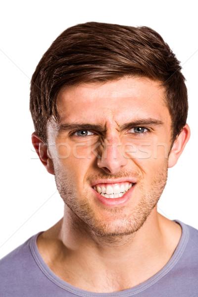 Angry young man growling at camera Stock photo © wavebreak_media