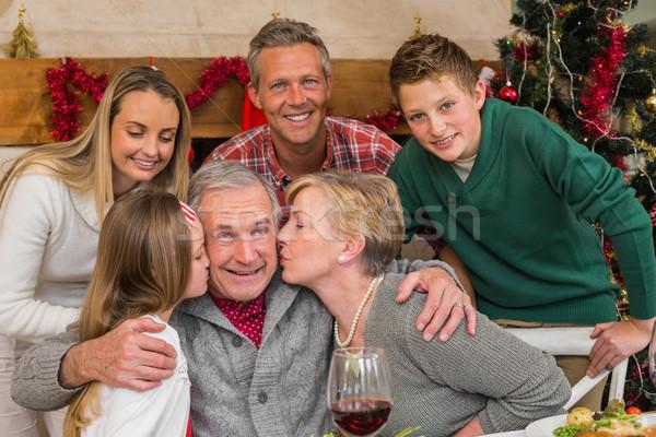 Famiglia bambina bacio nonno home soggiorno Foto d'archivio © wavebreak_media