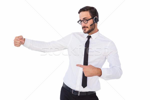 Businessman wearing a headset while showing something Stock photo © wavebreak_media