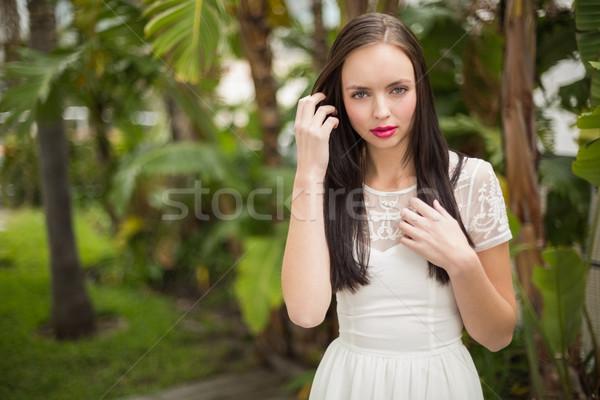 Bastante hippie olhando câmera fora jardim Foto stock © wavebreak_media