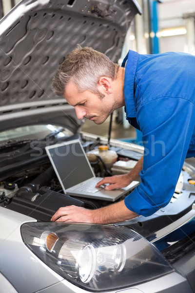 Mechanic using laptop on car Stock photo © wavebreak_media