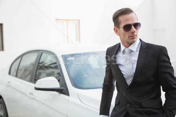 Serious businessman leaning against his car Stock photo © wavebreak_media