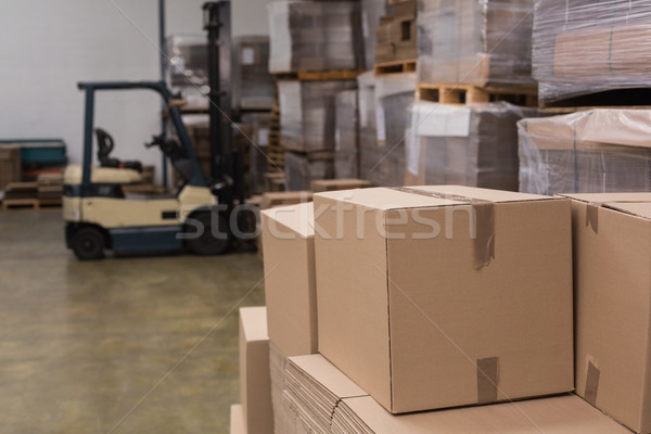 Forklift in a large warehouse Stock photo © wavebreak_media