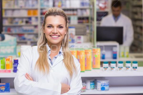 Pharmacien souriant caméra hôpital pharmacie femme Photo stock © wavebreak_media
