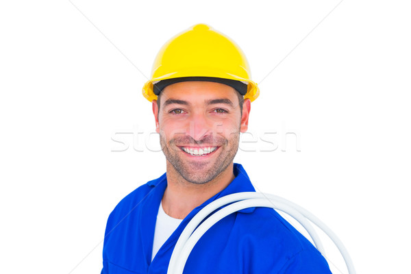 Electrician carrying wires over white background Stock photo © wavebreak_media