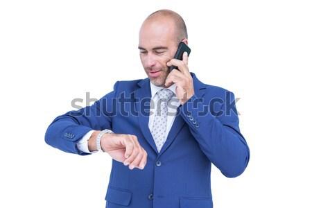 üzletember beszél telefon néz óra fehér Stock fotó © wavebreak_media