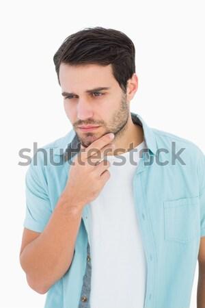 Handsome man thinking with finger on chin  Stock photo © wavebreak_media