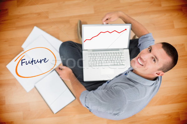 Stock photo: Future against young creative businessman working on laptop