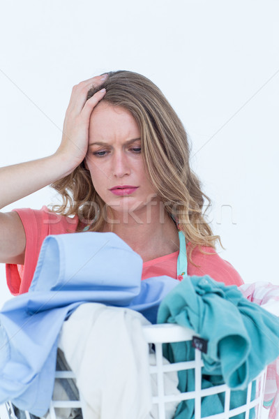 Woman looking at dirty clothes   Stock photo © wavebreak_media