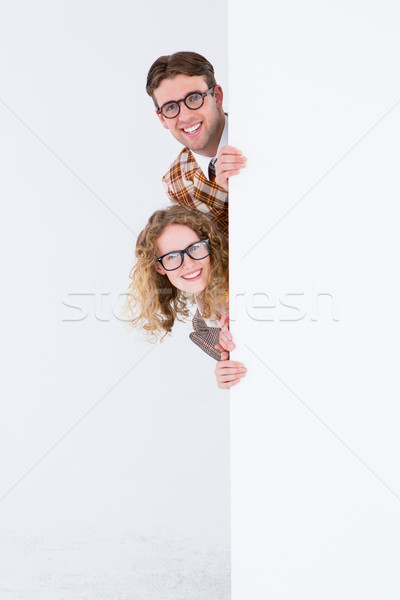 Geeky hipster holding poster and smiling at camera  Stock photo © wavebreak_media