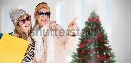 Composite image of beautiful women holding shopping bags pointin Stock photo © wavebreak_media