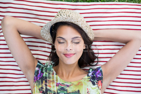 Smiling beautiful brunette lying on the blanket Stock photo © wavebreak_media