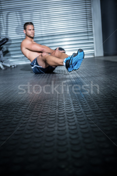 Gespierd man oefening geneeskunde bal crossfit Stockfoto © wavebreak_media