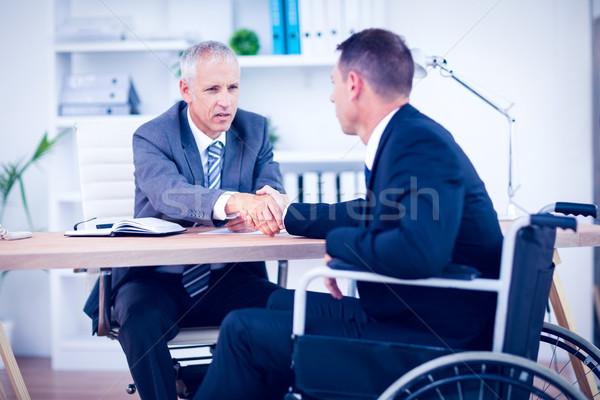 Affaires fauteuil roulant parler collègue bureau homme Photo stock © wavebreak_media