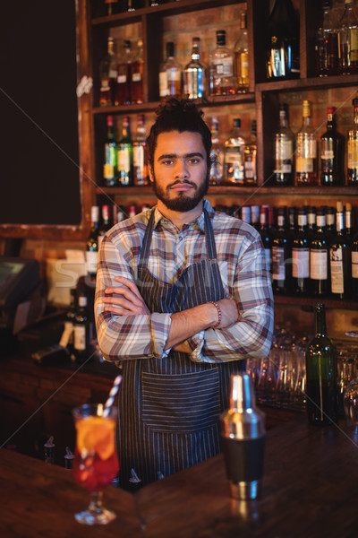 Portrait of waiter standing with arms crossed at counter Stock photo © wavebreak_media