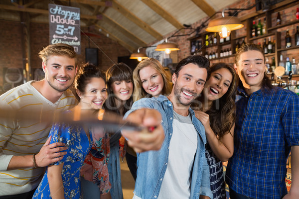 Happy friends taking selfie in pub Stock photo © wavebreak_media