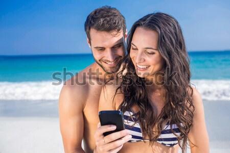 Feliz Pareja toma sesión playa arena Foto stock © wavebreak_media