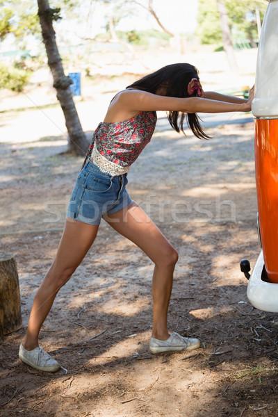 Woman pushing a camper van in the park Stock photo © wavebreak_media