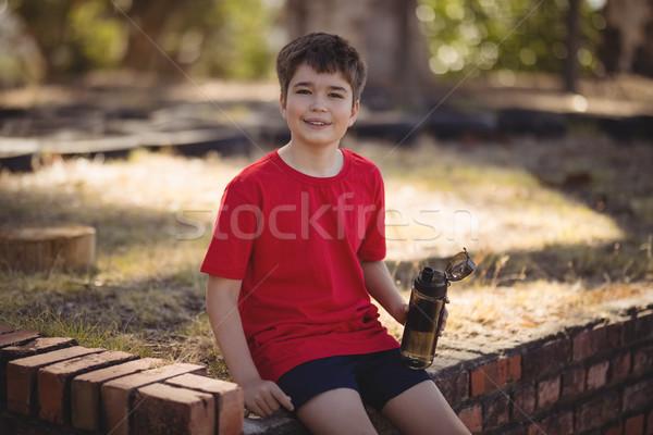 Portré vidám fiú megnyugtató edzés akadályfutás csizma Stock fotó © wavebreak_media