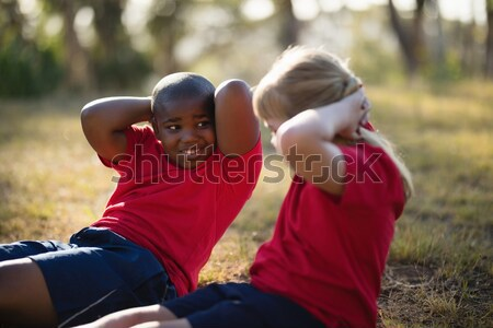 Portrait of happy kids exercising during obstacle course Stock photo © wavebreak_media
