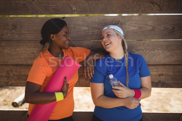 Friends interacting with each other after workout during obstacle course Stock photo © wavebreak_media