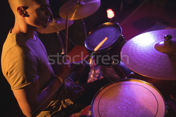 Drummer playing in illuminated nightclub Stock photo © wavebreak_media