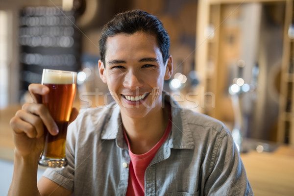 Man having beer in a restaurant Stock photo © wavebreak_media