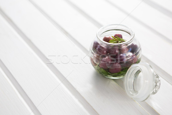 Marinated olives with herbs in a glass jar on table Stock photo © wavebreak_media
