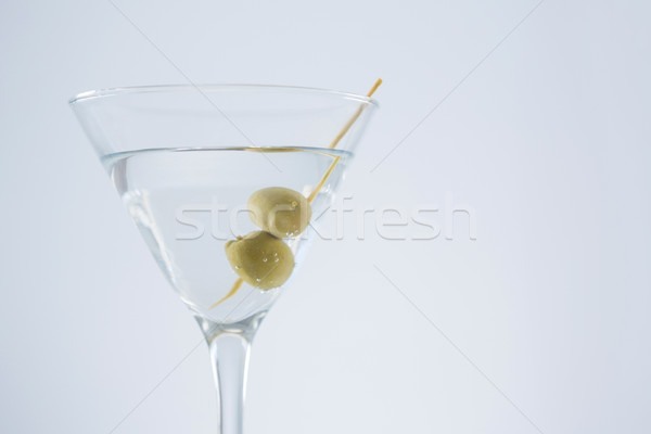 Cocktail martini with olives on table Stock photo © wavebreak_media