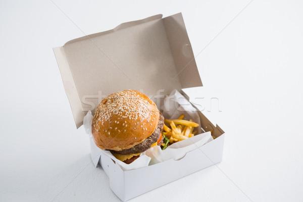 Hamburger patatine fritte finestra tavola carta Foto d'archivio © wavebreak_media