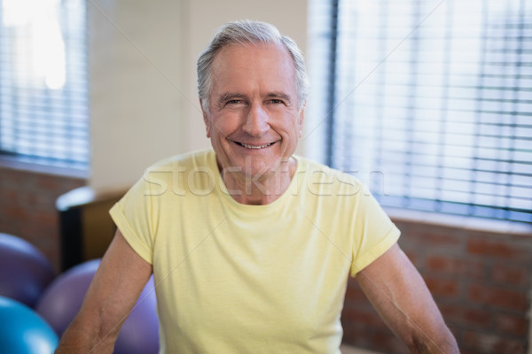 Portrait of smiling senior male patient against window Stock photo © wavebreak_media