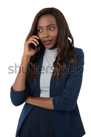 Woman looking away while talking on mobile phone Stock photo © wavebreak_media