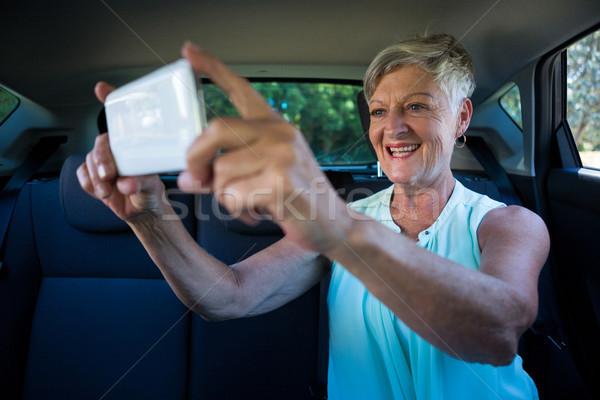 Senior woman taking selfie on mobile phone Stock photo © wavebreak_media