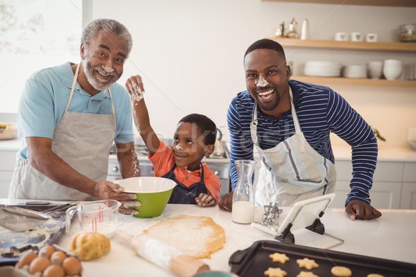 Chłopca gry mąka cookie ojciec dziadek Zdjęcia stock © wavebreak_media