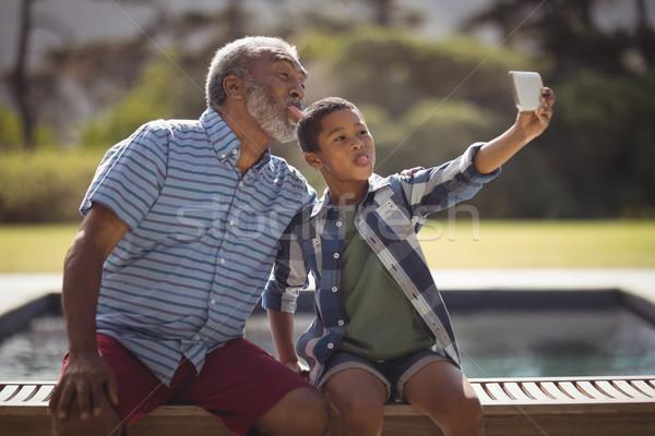 внук деда мобильного телефона ребенка пожилого Сток-фото © wavebreak_media