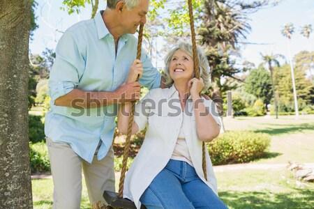 Doctor assisting woman in walking at backyard Stock photo © wavebreak_media