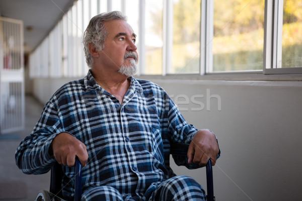 Thoughtful senior man sitting on wheelchair in nursing home Stock photo © wavebreak_media