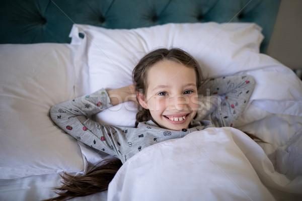 улыбаясь девушки кровать спальня портрет ребенка Сток-фото © wavebreak_media
