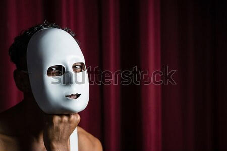 Artist wearing white mask on his face in stage Stock photo © wavebreak_media