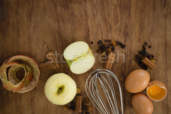 Overhead view of wire whisk with apple and spices Stock photo © wavebreak_media