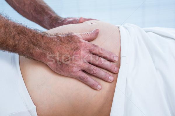 Közelkép terapeuta üzenetküldés has terhes nő egészség Stock fotó © wavebreak_media