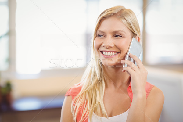Beautiful businesswoman talking on phone Stock photo © wavebreak_media