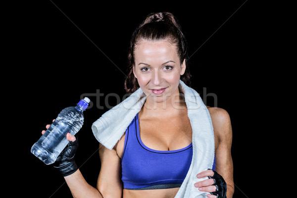 Portrait joli femme souriante une bouteille d'eau noir femme Photo stock © wavebreak_media