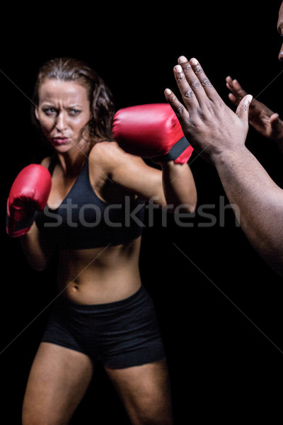 женщины истребитель тренер стороны черный женщину Сток-фото © wavebreak_media
