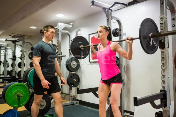 Encajar mujer pesado barra con pesas pesos Foto stock © wavebreak_media
