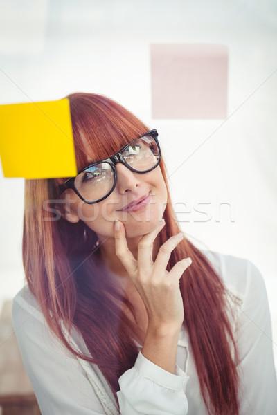 Atrakcyjny zamyślony kobieta stwarzające biuro Zdjęcia stock © wavebreak_media