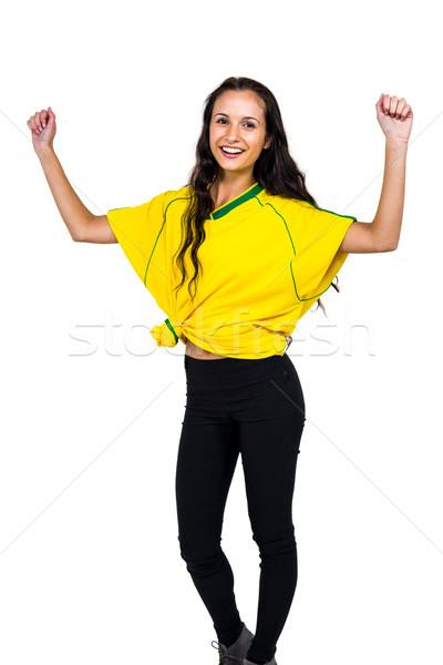 Vonzó nő ujjongás fehér képernyő szépség Stock fotó © wavebreak_media