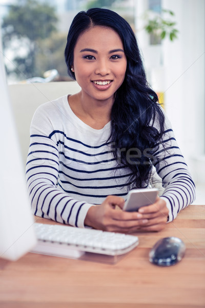 улыбаясь азиатских женщину смартфон служба бизнеса Сток-фото © wavebreak_media