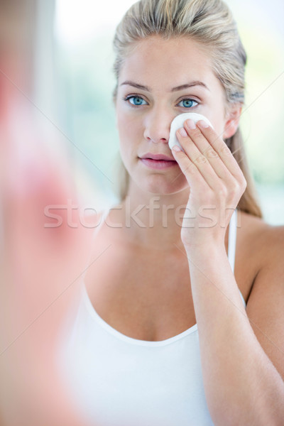 Woman wiping her face with cotton pad Stock photo © wavebreak_media